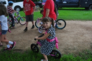 "Beanie rode her ""glide bike"" in the fourth of July parade."